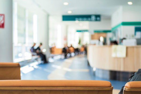 soft focus of patients waiting in a waiting room